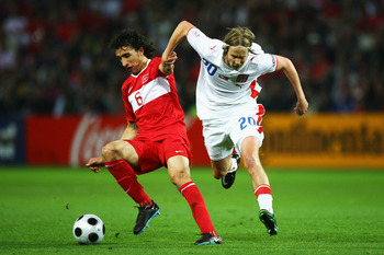 GENEVA - JUNE 15:  Mehmet Topal of Turkey and Jaroslav Plasil of Czech Republic battle for the ball during the UEFA EURO 2008 Group A match between Turkey and Czech Republic at Stade de Geneve on June 15, 2008 in Geneva, Switzerland.  (Photo by Alex Lives
