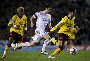 LEEDS, UNITED KINGDOM - JANUARY 19:  Jonathan Howson of Leeds United competes with Alexandre Song (L) and Laurent Koscielny of Arsenal during the FA Cup sponsored by E.On Third Round Replay match between Leeds United and Arsenal at Elland Road on January