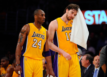 LOS ANGELES, CA - APRIL 20:  Kobe Bryant #24 and Pau Gasol #16 of the Los Angeles Lakers walk from the sideline while taking on the New Orleans Hornets in Game Two of the Western Conference Quarterfinals in the 2011 NBA Playoffs on April 20, 2011 at Stapl