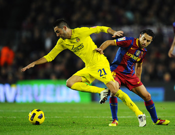 BARCELONA, SPAIN - NOVEMBER 13:  Xavi Hernandez of Barcelona (R) and Bruno Soriano of Villarreal duel for the ball during the La Liga match between Barcelona and Villarreal CF at Camp Nou Stadium on November 13, 2010 in Barcelona, Spain. Barcelona won the