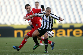 UDINE, ITALY - MARCH 06: Gokhan Inler of Udinese Calcio is tackled by Abdel Kader Ghezzal  during the Serie A match between Udinese Calcio and AS Bari at Stadio Friuli on March 6, 2011 in Udine, Italy.  (Photo by Gabriele Maltinti/Getty Images)