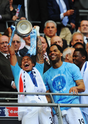 LONDON, ENGLAND - MAY 14: Nigel de Jong of Manchester City celebrates with the trophy after his sides victory during the FA Cup sponsored by E.ON Final match between Manchester City and Stoke City at Wembley Stadium on May 14, 2011 in London, England. (Ph