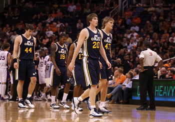 PHOENIX - OCTOBER 12:  Gordon Hayward #20 of the Utah Jazz walks back to the bench with teammates during the preseason NBA game against the Phoenix Suns at US Airways Center on October 12, 2010 in Phoenix, Arizona. NOTE TO USER: User expressly acknowledge