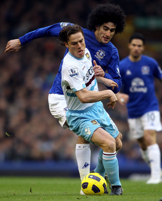 LIVERPOOL, ENGLAND - JANUARY 22:  Scott Parker of West Ham in action with Marouane Fellaini of Everton during the Barclays Premier League match at Goodison Park on January 22, 2011 in Liverpool, England.  (Photo by Scott Heavey/Getty Images)