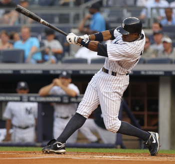 NEW YORK, NY - JUNE 28: Curtis Granderson #14 of the New York Yankees hits an RBI triple in the first inning against the Milwaukee Brewers during their game on June 28, 2011 at Yankee Stadium in the Bronx borough of New York City.  (Photo by Nick Laham/Ge