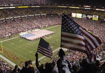 An American Flag at mid-field during half time as  the Washington Redskins host the Minnesota Vikings  on ESPN Monday Night Football September 11, 2006 in Washington.  The Vikings won 19 - 16.  (Photo by Al Messerschmidt/Getty Images)
