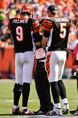 CINCINNATI, OH - OCTOBER 10: Quarterbacks Carson Palmer #9 and Jordan Palmer #5 of the Cincinnati Bengals talk with a coach during a game against the Tampa Bay Buccaneers at Paul Brown Stadium on October 10, 2010 in Cincinnati, Ohio. (Photo by Jamie Sabau