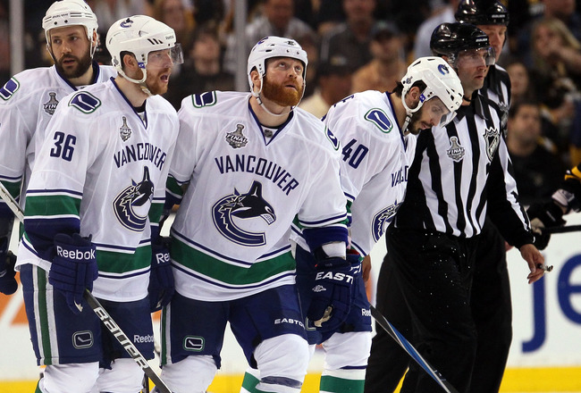 BOSTON, MA - JUNE 06:  Sami Salo #6, Andrew Alberts #41, Jannik Hansen #36, Raffi Torres #13 and Maxim Lapierre #40 of the Vancouver Canucks look on towards the end Game Three against the Boston Bruins in the 2011 NHL Stanley Cup Final at TD Garden on Jun