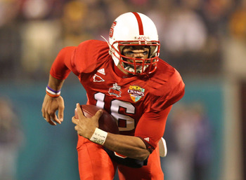 ORLANDO, FL - DECEMBER 28:  Russell Wilson #16 of the North Carolina State Wolfpack rushes with the ball during the Champs Sports Bowl against the West Virginia Mountineers at Florida Citrus Bowl Stadium on December 28, 2010 in Orlando, Florida.  (Photo b