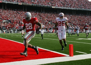COLUMBUS, OH - NOVEMBER 03: Chris Wells #28 of the Ohio State Buckeyes runs into the end zone for a second half touchdown as Shane Carter #25 of the Wisconsin Badgers trails the play on November 3, 2007 at Ohio Stadium in Columbus, Ohio. Ohio State defeat