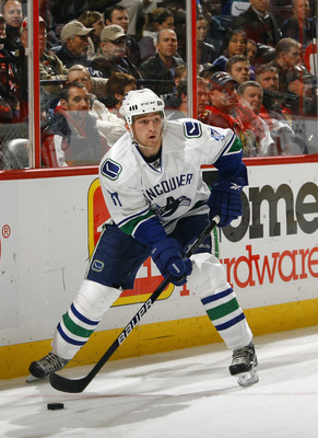 OTTAWA, CANADA - NOVEMBER 11:  Rick Rypien #37 of the Vancouver Canucks skates with the puck during a game against the Ottawa Senators at Scotiabank Place on November 11, 2010 in Ottawa, Ontario, Canada.  (Photo by Phillip MacCallum/Getty Images)