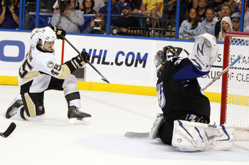 TAMPA, FL - APRIL 18: Arron Asham #45 of the Pittsburgh Penguins shoots and scores against Goaltender Dwayne Roloson #35 of the Tampa Bay Lightning in Game Three of the Eastern Conference Quarterfinals during the 2011 NHL Stanley Cup Playoffs at the St. P