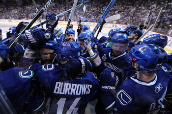 VANCOUVER, BC - JUNE 04:  Alex Burrows #14 of the Vancouver Canucks celebrates with his teammates after scoring a goal in overtime against Zdeno Chara #33 of the Boston Bruins to win Game Two of the 2011 NHL Stanley Cup Final at Rogers Arena on June 4, 20
