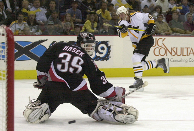 30 Apr 2001:  Mario Lemieux #66 of the Pittsburgh Penguins takes a shot that goes wide past goaltender Dominic Hasek #39 of the Buffalo Sabres as the Sabres defeated the Penguins 4-1 in game three of their Eastern Conference Playoff Semifinal of the 2001