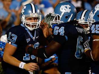 CHAPEL HILL, NC - OCTOBER 22:  T.J. Yates #13 of the North Carolina Tar Heels celebrates with teammate Jonathan Cooper #64 after a scond half touchdown against the Florida State Seminoles at Kenan Stadium on October 22, 2009 in Chapel Hill, North Carolina