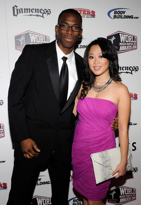 LAS VEGAS, NV - DECEMBER 01:  Mixed martial artist Anthony Njokuani (L) and Cindy Nguyen arrive at the third annual Fighters Only World Mixed Martial Arts Awards 2010 at the Palms Casino Resort December 1, 2010 in Las Vegas, Nevada.  (Photo by Ethan Mille