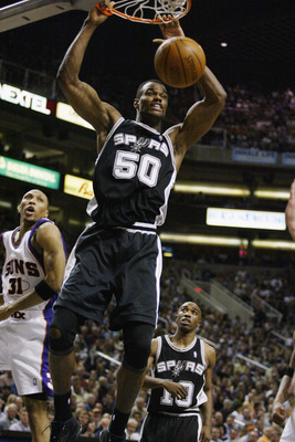 PHOENIX,  AZ - APRIL 25:  David Robinson #50 of the San Antonio Spurs slam dunks in Game three of the Western Conference Quarterfinals against the Phoenix Suns during the 2003 NBA Playoffs at America West Arena on April 25, 2003 in Phoenix, Arizona.  The