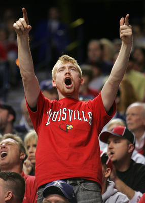 LEXINGTON, KY - MARCH 17:  A Louisville Cardinals fan reacts during their 72 to 69 loss to the Texas A&M Aggies in round two of the NCAA Men's Basketball Tournament at Rupp Arena on March 17, 2007 in Lexington, Kentucky.  (Photo by Andy Lyons/Getty Images