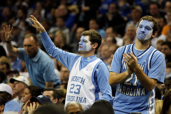 CHARLOTTE, NC - MARCH 20:  North Carolina Tar Heels fans cheer while taking on the Washington Huskies during the third round of the 2011 NCAA men's basketball tournament at Time Warner Cable Arena on March 20, 2011 in Charlotte, North Carolina.  (Photo by