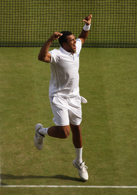 LONDON, ENGLAND - JUNE 29:  Jo-Wilfried Tsonga of France celebrates after winning his quarterfinal round match against Roger Federer of Switzerland on Day Nine of the Wimbledon Lawn Tennis Championships at the All England Lawn Tennis and Croquet Club on J