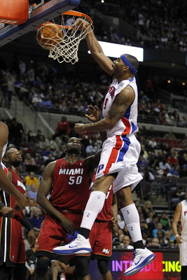 AUBURN HILLS, MI - FEBRUARY 11:  Chris Wilcox #9 of the Detroit Pistons gets in for a dunk over Joel Anthony #50 of the Miami Heat at The Palace of Auburn Hills on February 11, 2011 in Auburn Hills, Michigan. Miami won the game 106-92. NOTE TO USER: User