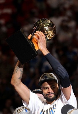 MIAMI, FL - JUNE 12:  Tyson Chandler #6 of the Dallas Mavericks celebrates with the Larry O'Brien Championship trophy after the Mavericks won 105-95 against the Miami Heat in Game Six of the 2011 NBA Finals at American Airlines Arena on June 12, 2011 in M