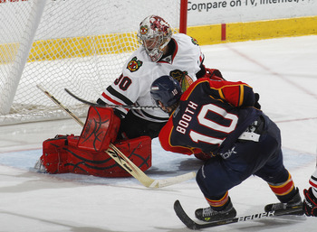 SUNRISE, FL - MARCH 8: Goaltender Marty Turco #30 of the Chicago Blackhawks stops a shot by David Booth #10 of the Florida Panthers on March 8, 2011 at the BankAtlantic Center in Sunrise, Florida. The Panthers defeated the Blackhawks 3-2. (Photo by Joel A