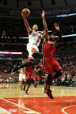 CHICAGO, IL - MAY 26:  Derrick Rose #1 of the Chicago Bulls drives for a shot attempt against Dwyane Wade #3 of the Miami Heat in Game Five of the Eastern Conference Finals during the 2011 NBA Playoffs on May 26, 2011 at the United Center in Chicago, Illi