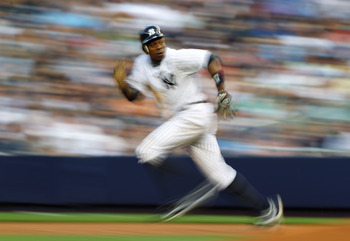 NEW YORK, NY - JUNE 29:  Curtis Granderson #14 of the New York Yankees steals second base against the Milwaukee Brewers during their game on June 29, 2011 at Yankee Stadium in the Bronx borough of New York City.  (Photo by Al Bello/Getty Images)