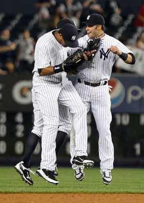 NEW YORK, NY - JUNE 28: Nick Swisher #33, Chris Dickerson #27 and Brett Gardner #11 of the New York Yankees celebrate the win against the Milwaukee Brewers during their game on June 28, 2011 at Yankee Stadium in the Bronx borough of New York City.  (Photo