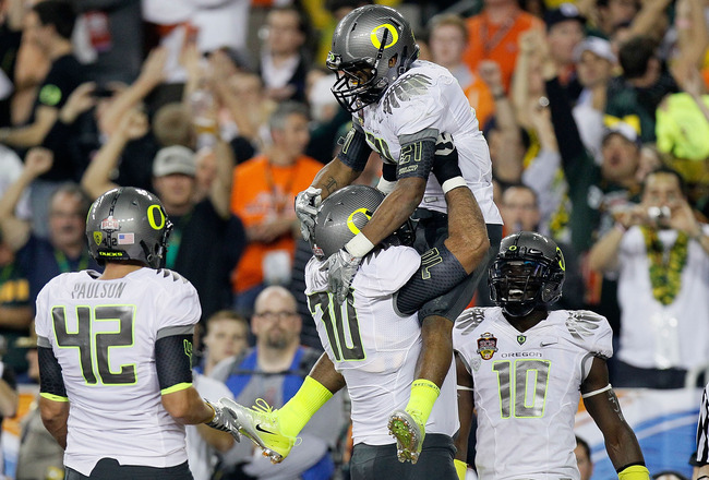 GLENDALE, AZ - JANUARY 10:  (R-L) LaMichael James #21 and Ramsen Golpashin #70 of the Oregon Ducks celebrate James' eight-yard touchdown reception in the second quarter against the Auburn Tigers during the Tostitos BCS National Championship Game at Univer