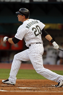 MIAMI GARDENS, FL - JUNE 10: Logan Morrison #20 of the Florida Marlins hits a two run home run against the Arizona Diamondbacks in the first inning at Sun Life Stadium on June 10, 2011 in Miami Gardens, Florida. (Photo by Eliot J. Schechter/Getty Images)