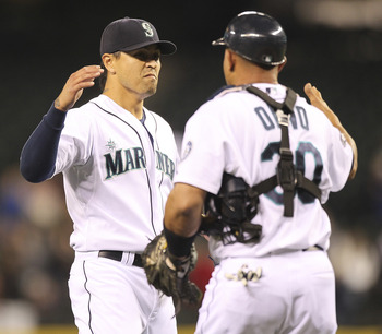 SEATTLE - JUNE 15:  Closing pitcher Brandon League #43 of the Seattle Mariners celebrates with catcher Miguel Olivo #30 after defeating the Los Angeles Angels of Anaheim 3-1 at Safeco Field on June 15, 2011 in Seattle, Washington. (Photo by Otto Greule Jr