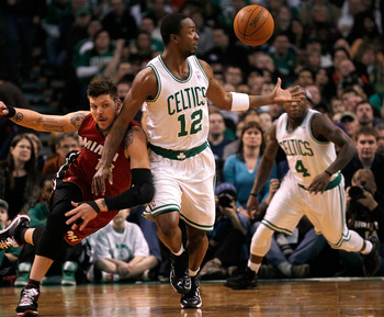 BOSTON - FEBRUARY 13:  Von Wafer #12 of the Boston Celtics battles Dexter Pittman #13 of the Miami Heat for a loose ball at TD Garden on February 13, 2011 in Boston, Massachusetts. The Celtics won 85-82. NOTE TO USER: User expressly acknowledges and agree