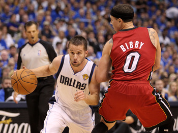 DALLAS, TX - JUNE 07:  Jose Juan Barea #11 of the Dallas Mavericks drives against Mike Bibby #0 of the Miami Heat in Game Four of the 2011 NBA Finals at American Airlines Center on June 7, 2011 in Dallas, Texas. NOTE TO USER: User expressly acknowledges a
