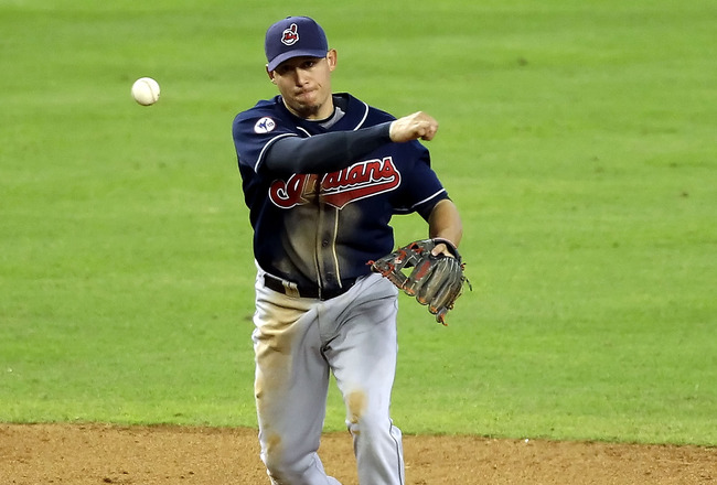 PHOENIX, AZ - JUNE 29:  Infielder Asdrubal Cabrera #13 of the Cleveland Indians fields a ground ball out against the Arizona Diamondbacks during the Major League Baseball game at Chase Field on June 29, 2011 in Phoenix, Arizona.  The Indians defeated the
