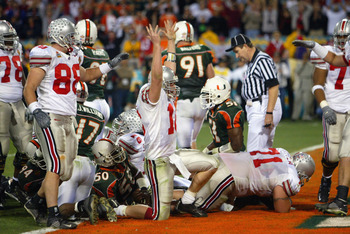 TEMPE, AZ - JANUARY 3:  Quarterback Craig Krenzel #16 of the Ohio State Buckeyes scores the team's first touchdown in overtime against the University of Miami Hurricanes during the Tostitos Fiesta Bowl at Sun Devil Stadium on January 3, 2003 in Tempe, Ari