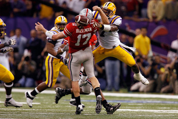 NEW ORLEANS - JANUARY 07:  Todd Boeckman #17 of the Ohio State Buckeyes fumbles the ball as he is hit by Jermale Hines #7 of the Louisiana State University Tigers during the fourth quarter of the AllState BCS National Championship on January 7, 2008 at th