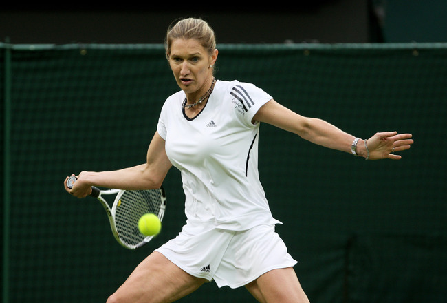 LONDON, ENGLAND - MAY 17:  Steffi Graf hits a forehand during the Ladies Singles match against Kim Clijsters during the 'Centre Court Celebration' at Wimbledon on May 17, 2009 in London, England.  (Photo by Hamish Blair/Getty Images)