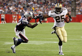 FOXBORO, MA - AUGUST 12: Reggie Bush # 25 of the New Orleans Saints scores a touchdown against the defense of Darius Butler # 28 of the New England Patriots during the preseason game against the New England Patriots at Gillette Stadium on August 12, 2010