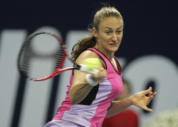 ZURICH, SWITZERLAND - OCTOBER 16:  Mary Pierce of France in action as she loses to Katarina Srebotnik of Slovenia during the First round of the WTA Zurich Open at the Hallenstadion on October 16, 2006 in Zurich, Switzerland.  (Photo by Christopher Lee/Get