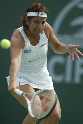 13 Mar 2002:  Arantxa Sanchez-Vicario of Spain returns a shot to Monica Seles of the USA  at the Pacific Life Open in Indian Wells, California.   DIGITAL IMAGE Mandatory Credit: Al Bello/Getty Images