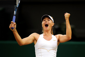 LONDON, ENGLAND - JUNE 28:  Maria Sharapova of Russia celebrates match point after winning her quarterfinal round match against Dominika Cibulkova of Slovakia on Day Eight of the Wimbledon Lawn Tennis Championships at the All England Lawn Tennis and Croqu