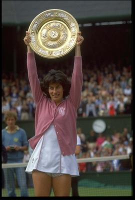 1 JUL 1977:  VIRGINIA WADE OF GREAT BRITAIN RAISES THE TROPHY ABOVE HER HEAD AFTER WINNING THE 1977 WIMBLEDON TENNIS CHAMPIONSHIPS. WADE DEFEATED BETTY STOVE OF HOLLAND 4-6, 6-3, 6-1 IN THE FINAL.
