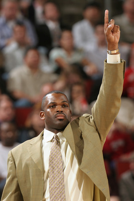 SEATTLE - MARCH 4:  Head coach Nate McMillan of the Seattle Sonics points during the game against the Detroit Pistons on March 4, 2005 at Key Arena in Seattle, Washington.  The Sonics won 95-87.  NOTE TO USER: User expressly acknowledges and agrees that,