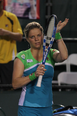 KEY BISCAYNE, FL - MARCH 29:  Kim Clijsters of Belgium celebrates after she own her match against Ana Ivanovic of Serbia during the Sony Ericsson Open at Crandon Park Tennis Center on March 29, 2011 in Key Biscayne, Florida.  (Photo by Al Bello/Getty Imag