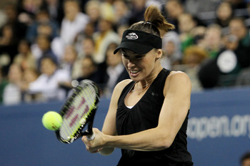 NEW YORK - SEPTEMBER 09:  Martina Hingis play against Pat Cash and Mats Wilander during day eleven of the 2010 U.S. Open at the USTA Billie Jean King National Tennis Center on September 9, 2010 in the Flushing neighborhood of the Queens borough of New Yor
