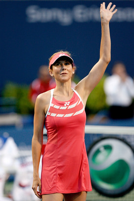 TORONTO, ON - AUGUST 17:  Former champion Monica Seles acknowledges the crowd at her induction ceremony into the Rogers Cup Hall of Fame during the Rogers Cup at the Rexall Center on August 17, in Toronto, Ontario, Canada.  (Photo by Matthew Stockman/Gett