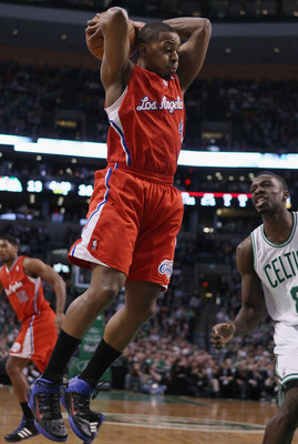 BOSTON, MA - MARCH 09:  Randy Foye #4 of the Los Angeles Clippers grabes the rebound before Jeff Green #8 of the Boston Celtics on March 9, 2011 at the TD Garden in Boston, Massachusetts. NOTE TO USER: User expressly acknowledges and agrees that, by downl
