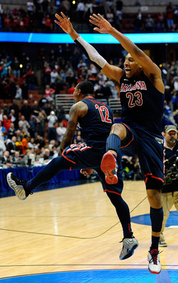 ANAHEIM, CA - MARCH 24:  Lamont Jones #12 and Derrick Williams #23 of the Arizona Wildcats reacts after defeating the Duke Blue Devils during the west regional semifinal of the 2011 NCAA men's basketball tournament at the Honda Center on March 24, 2011 in